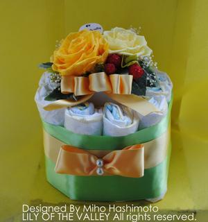 オムツケーキ レモンイエローのリボンケーキ